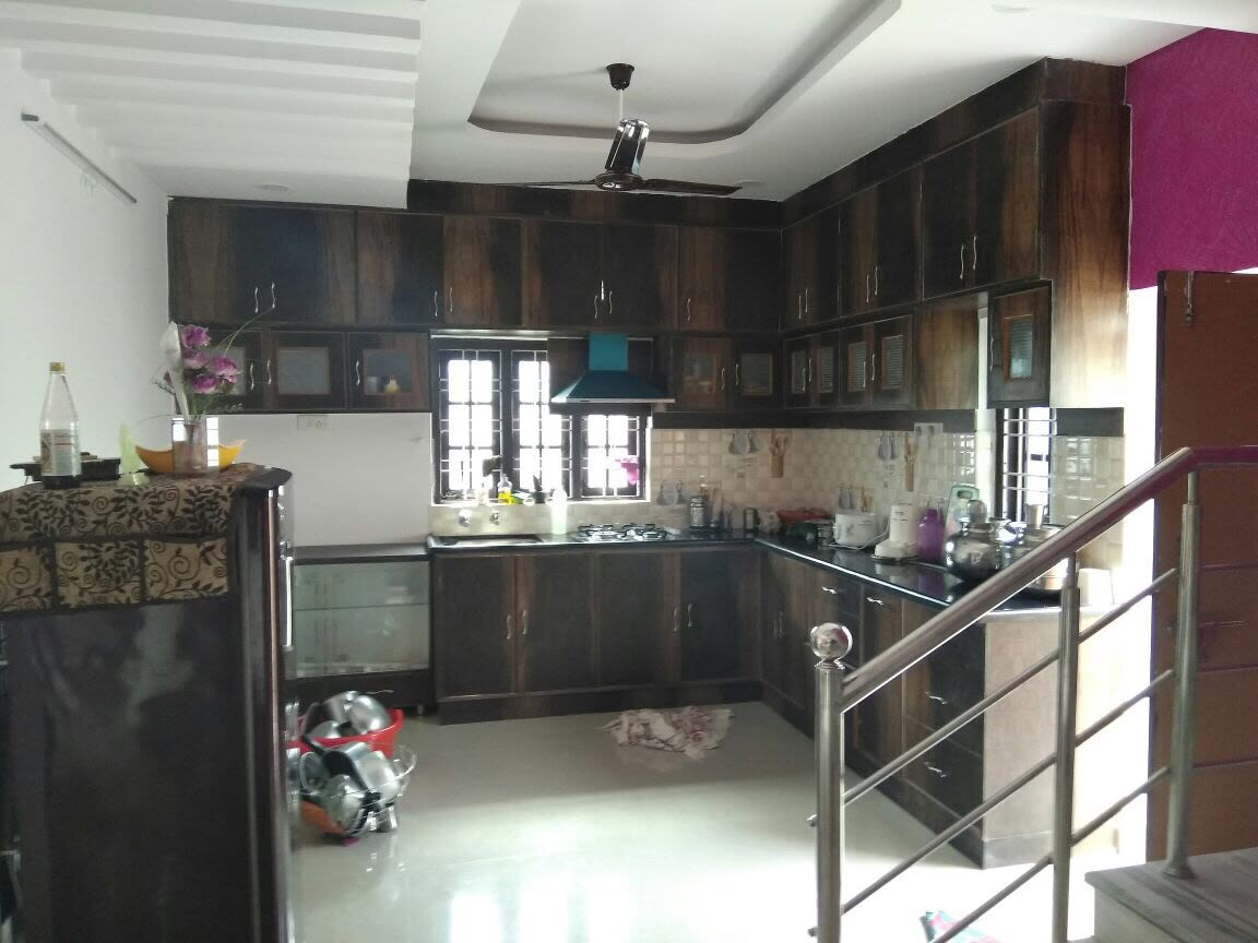 Brown L shaped kitchen with cabinets by Shiva Interiors Modular-kitchen   Interior Design Photos & Ideas