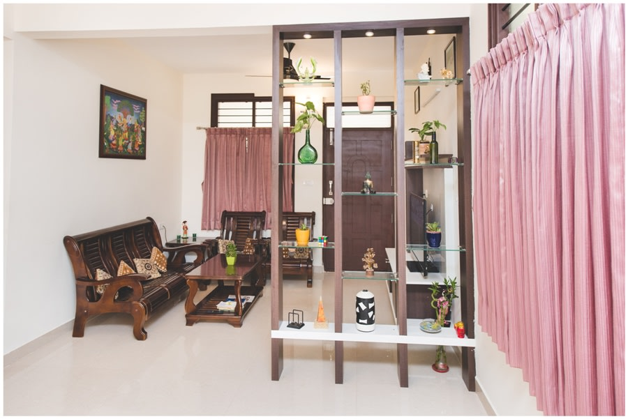 Traditionally Styled Living Room with Wooden Shelf and Pink Curtains by Shyama Viswanathan Living-room Traditional | Interior Design Photos & Ideas