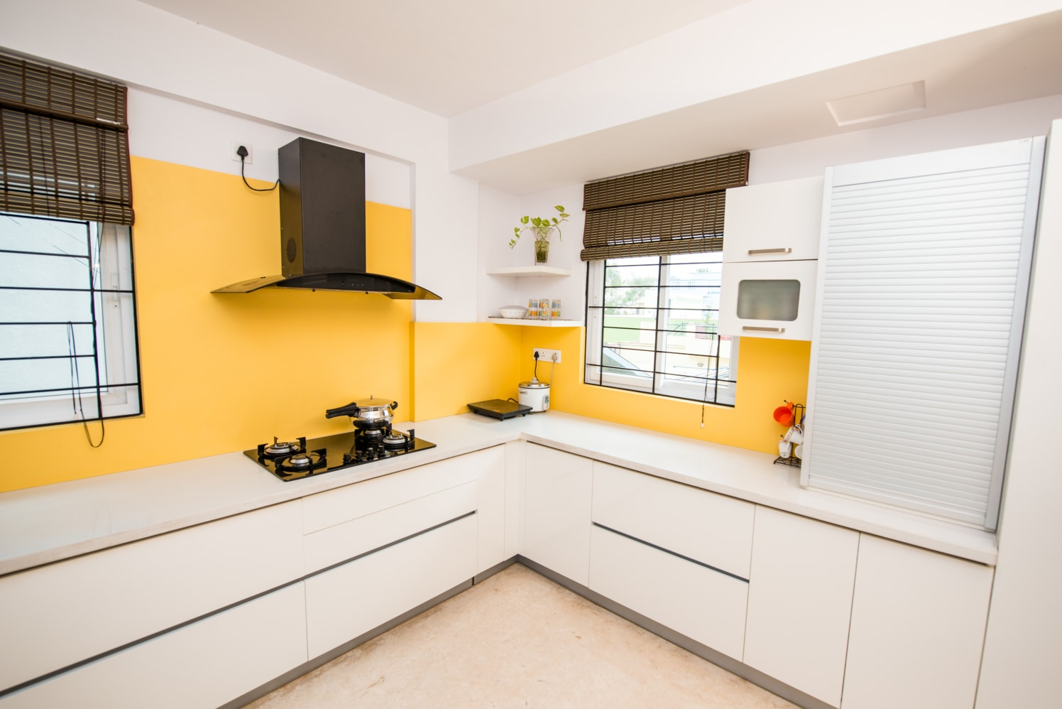 White Themed Modular Kitchen with L Shaped Counter and Yellow Walls by Shyama Viswanathan Modular-kitchen Contemporary | Interior Design Photos & Ideas