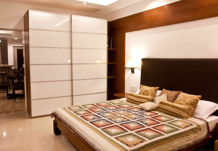 Gold and White Master bedroom by Dinsignia Architects And Interiors Bedroom Modern | Interior Design Photos & Ideas