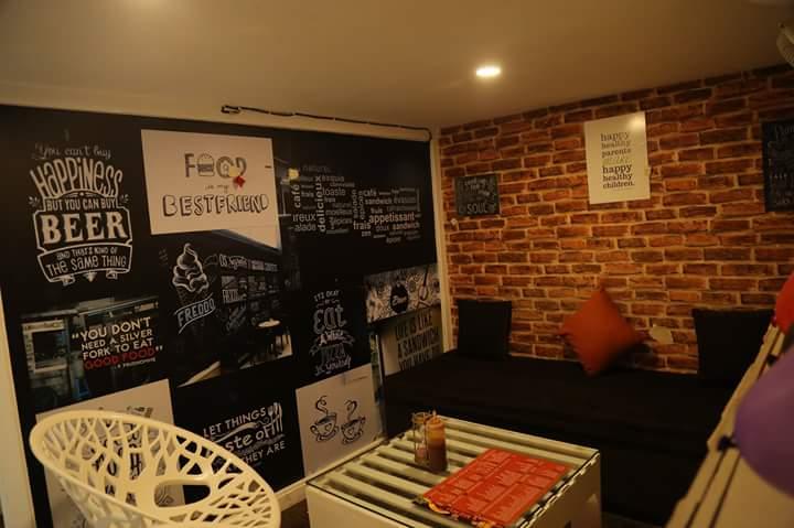 Casual Cafe with Cozy Lounge Sitting by Ajinkya Chinchkar Contemporary | Interior Design Photos & Ideas