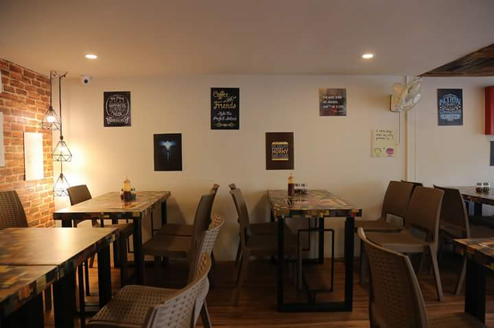 European-Themed Restaurant with Brick Textured Wall by Ajinkya Chinchkar Contemporary | Interior Design Photos & Ideas