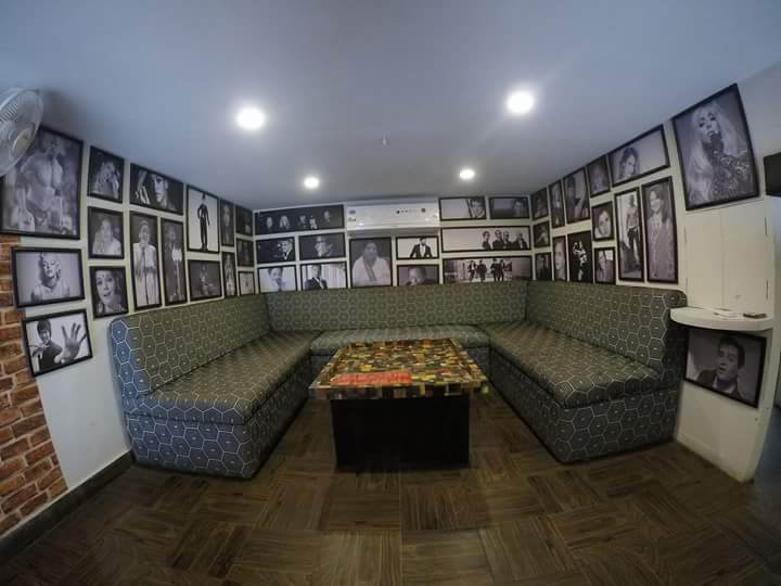 Cafe Lounge Seating with Legends On Wall by Ajinkya Chinchkar Contemporary | Interior Design Photos & Ideas