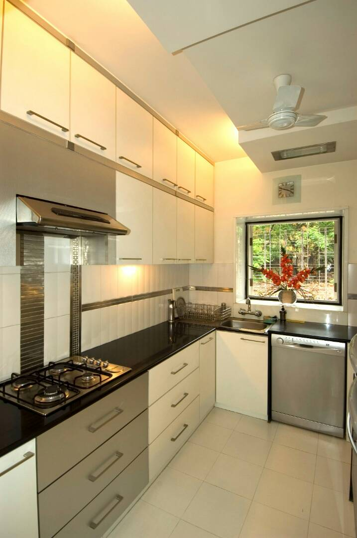 Kitchen With Pale Shade Cabinets by Nikeeta Mehta Modular-kitchen Modern | Interior Design Photos & Ideas