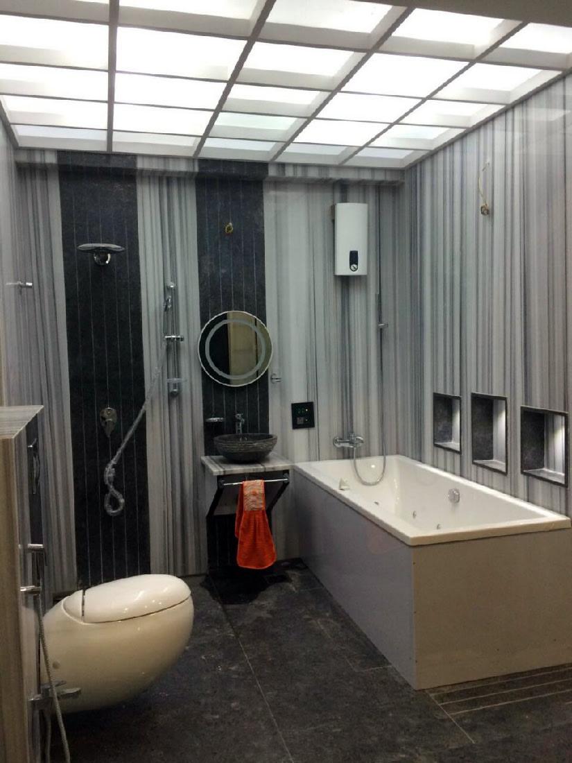 Grey and black walled bathroom with modern white fixtures by Bhagyashree Prajapati Bathroom Modern | Interior Design Photos & Ideas