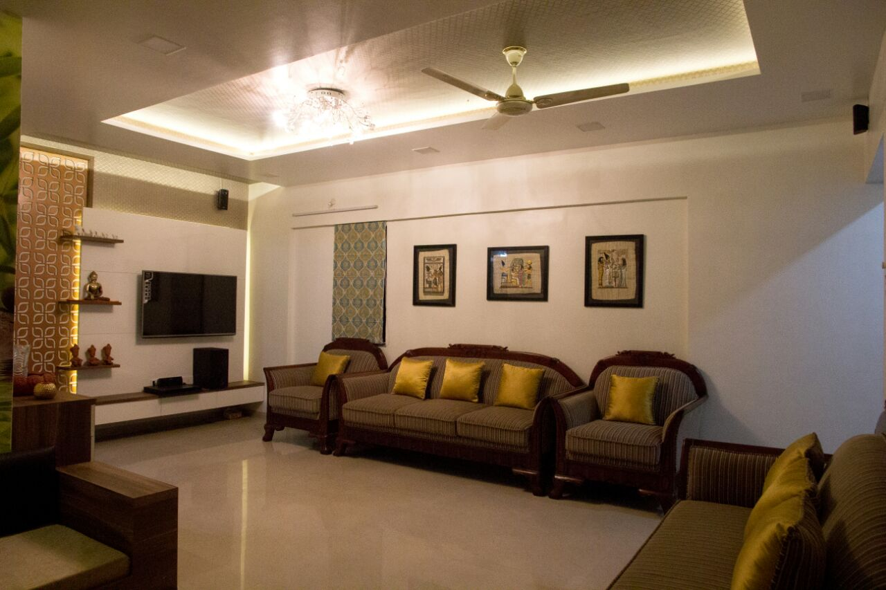 Living room with brown sofa and  marble flooring with false ceiling by Bhagyashree Prajapati Contemporary | Interior Design Photos & Ideas