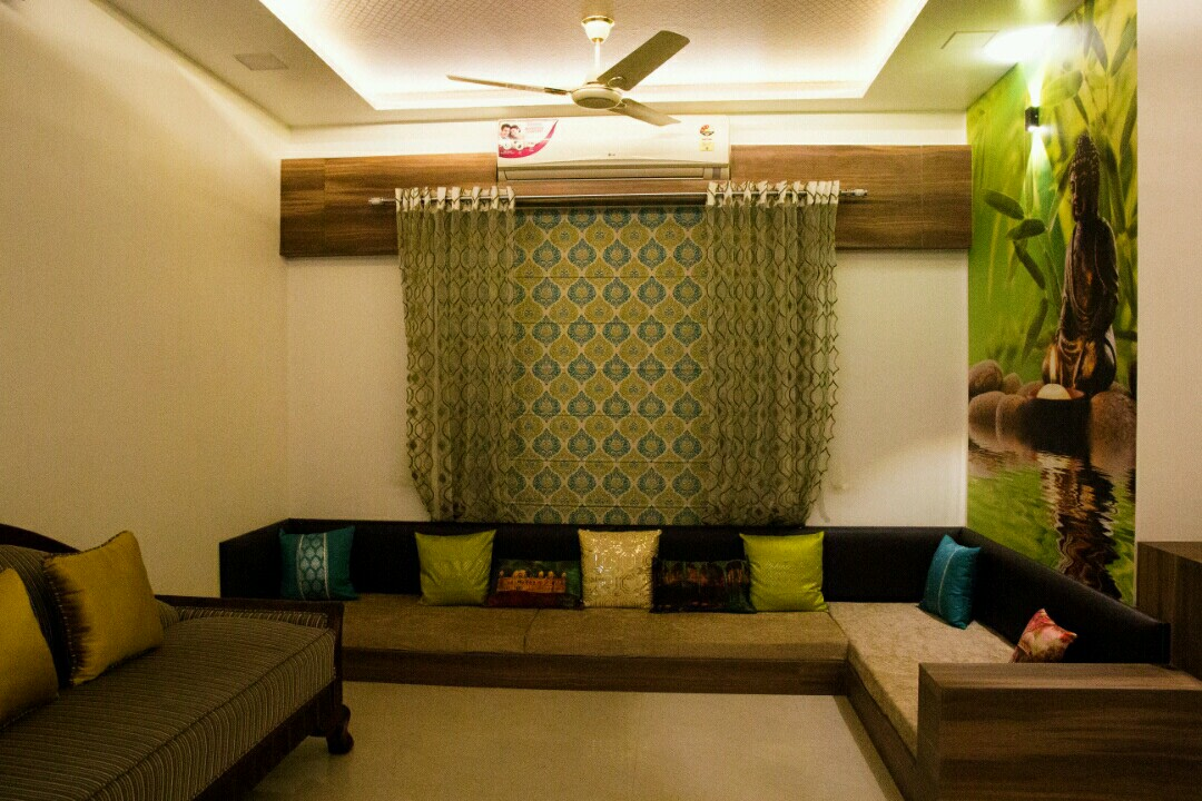 Low rise sectional sofa with Green Buddha wall art by Bhagyashree Prajapati Living-room Contemporary | Interior Design Photos & Ideas