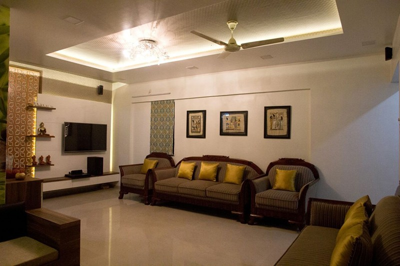 Living room with brown sofa and  marble flooring with false ceiling by Bhagyashree Prajapati Living-room Modern | Interior Design Photos & Ideas