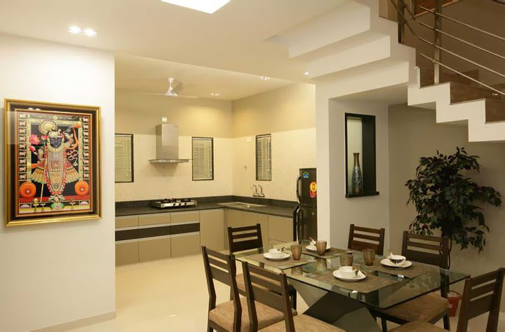 Open kitchen with dining area by Jitesh Dhoka Modern | Interior Design Photos & Ideas