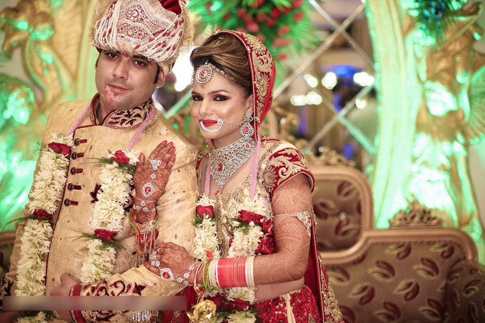 Bride And Groom Wedding Day Attire by Mohit Wedding-photography Groom-wear-and-accessories Bridal-jewellery-and-accessories Bridal-makeup | Weddings Photos & Ideas