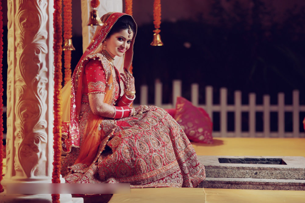 Delicate Gold Work On A Red Lehenga For The Bride by Mohit Wedding-photography Wedding-dresses | Weddings Photos & Ideas