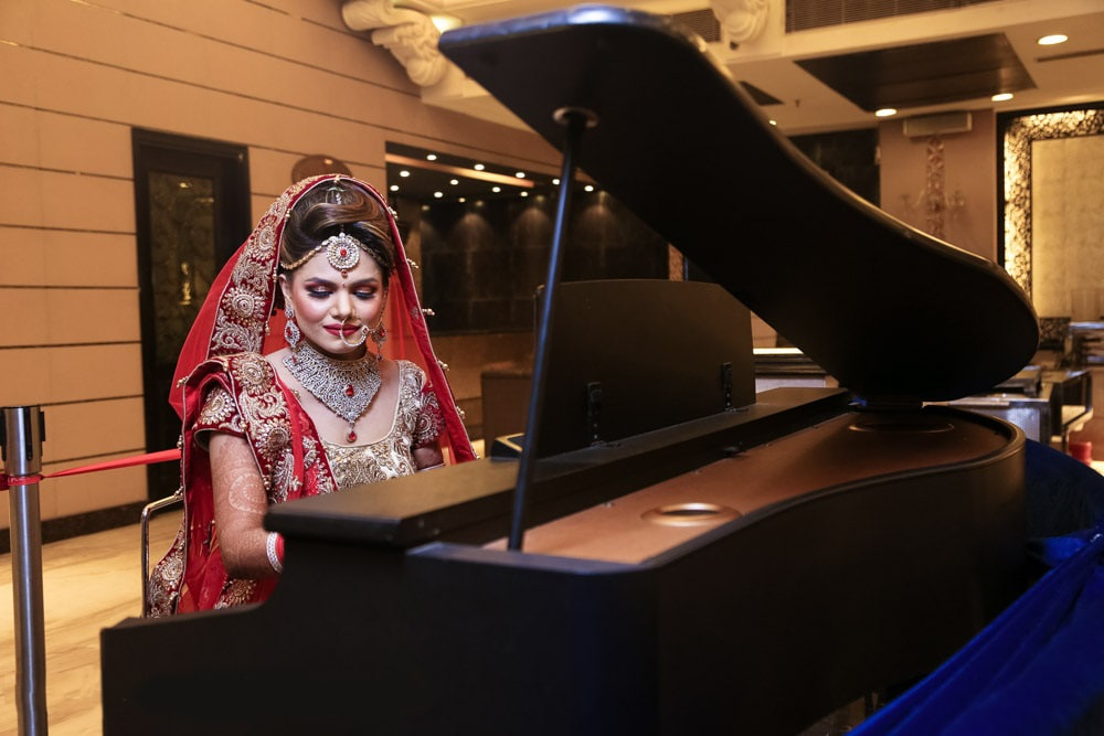 Bride Adorning Diamond Jewels Playing On Piano by Mohit Wedding-photography | Weddings Photos & Ideas