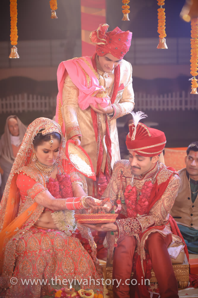 Couple Performing Wedding Rituals by Mohit Wedding-photography | Weddings Photos & Ideas