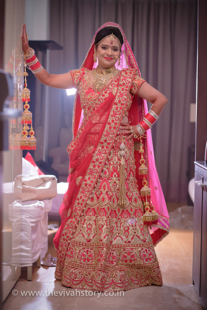 Red Shaded Bridal Lehenga With Gold Work For The Wedding Day by Mohit Wedding-photography Wedding-dresses | Weddings Photos & Ideas