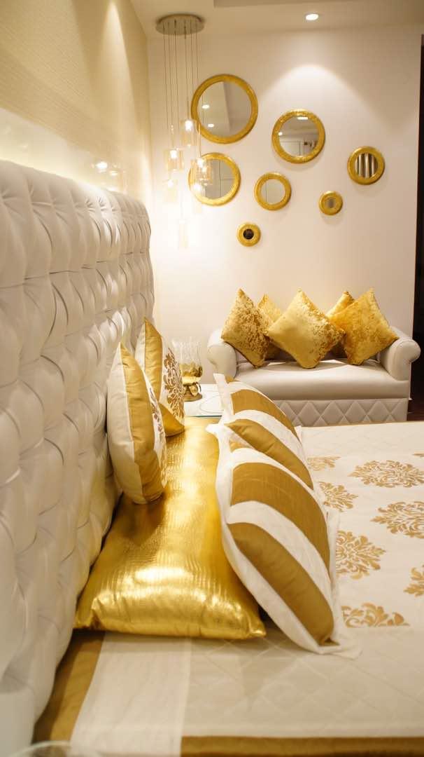 golden bedroom by Aashna Jain  Modern | Interior Design Photos & Ideas