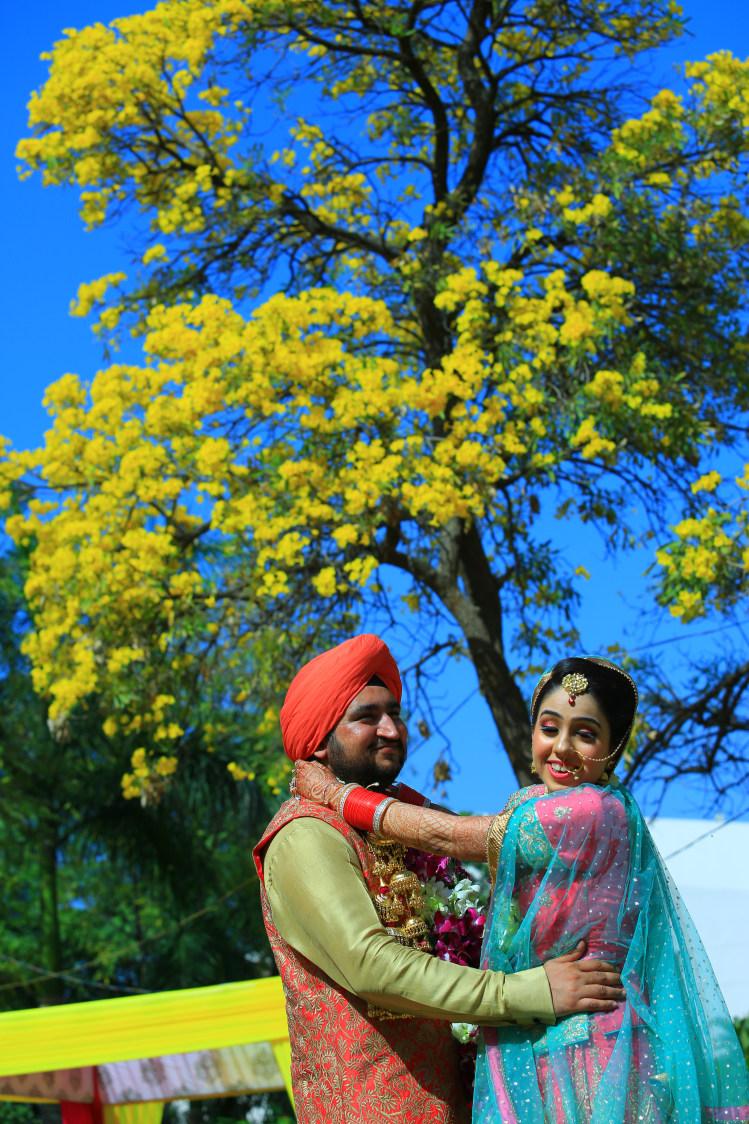 Punjabi Bride and Groom Posing on Their Wedding Day by Amit Kumar Wedding-photography | Weddings Photos & Ideas