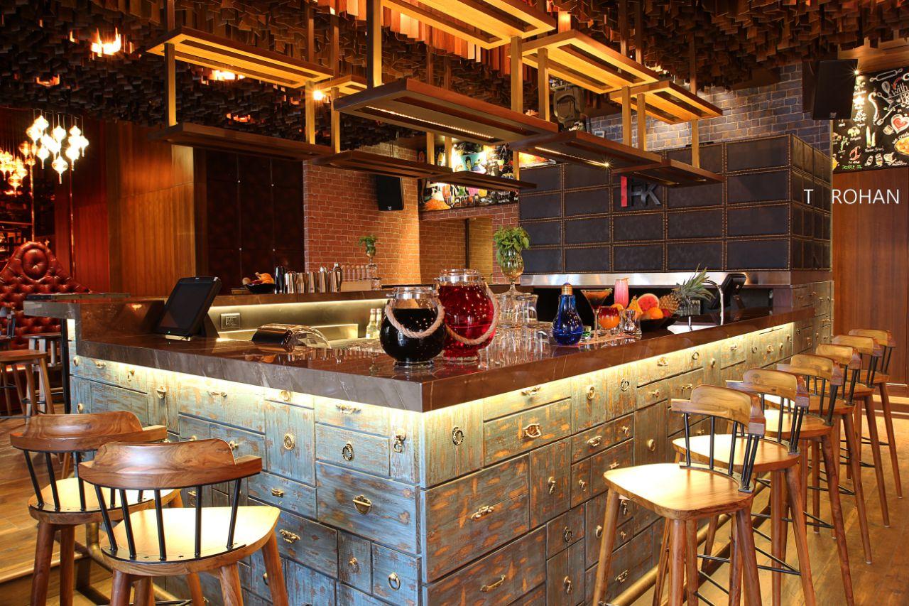 Stylish restaurant by Rohan Tapkire Modern | Interior Design Photos & Ideas
