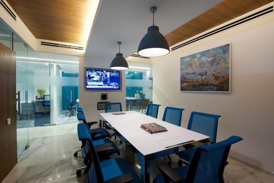 Cellular office space with white table and blue chairs with false ceiling by Siraj Contemporary | Interior Design Photos & Ideas
