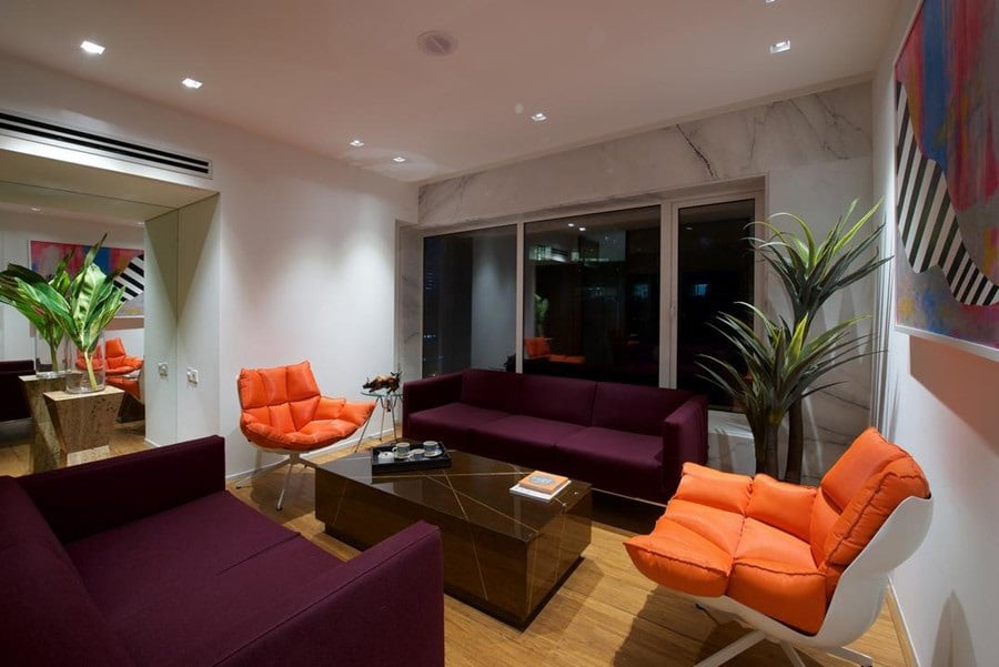 Lavishing living area with sofa and orange couch by Siraj Living-room Contemporary | Interior Design Photos & Ideas