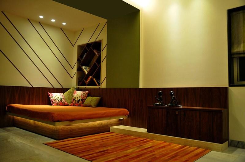 Buff Shaded Bedroom With Textured Wall by Chaitali D Parikh Bedroom Contemporary | Interior Design Photos & Ideas