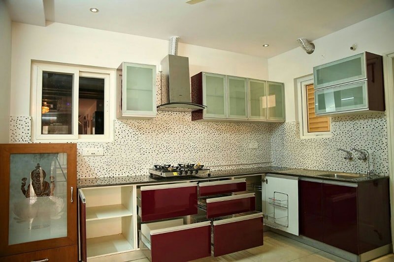 Modular L Shaped Kitchen with Burgundy Cabinets and Black ...