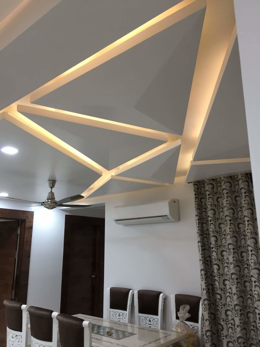 Edgy False Ceiling with Yellow Back Light by Madhu Gunisetti Living-room Modern | Interior Design Photos & Ideas