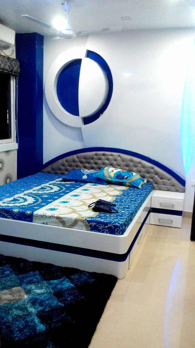 Blue bedroom with Queen Size bed and Blue Wall Design by Madhu Gunisetti Bedroom Modern | Interior Design Photos & Ideas