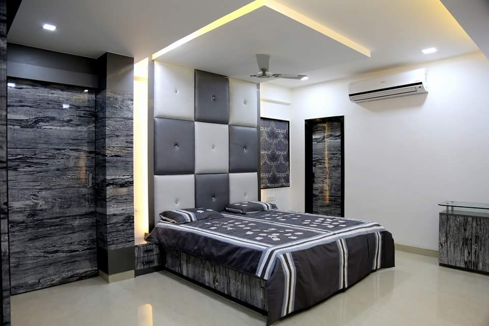 Grey Themed Bedroom with Queen Size Bed and Grey Cushioned Headboard by Madhu Gunisetti Bedroom Modern | Interior Design Photos & Ideas