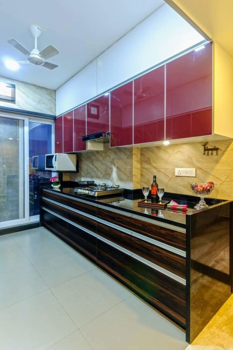 Modular Kitchen with Red Cabinets and Black Counter Top by Madhu Gunisetti Modular-kitchen Modern | Interior Design Photos & Ideas