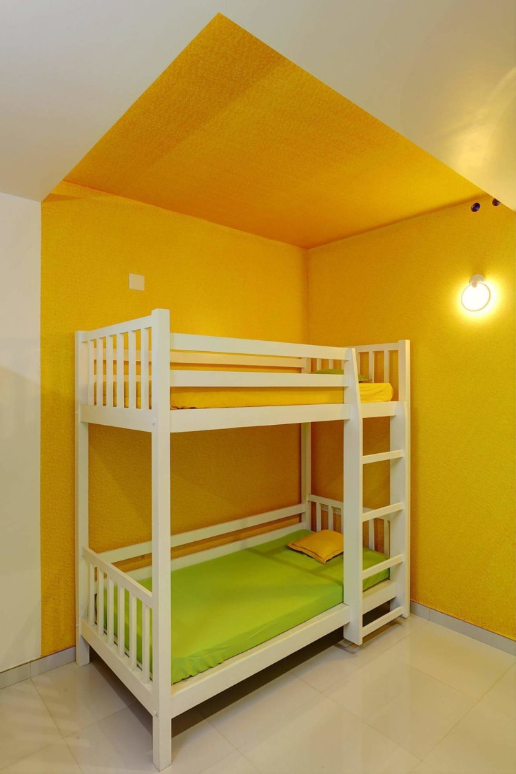 Simple Kids Bedroom with Wooden Bunk Bed and Yellow Wall by Madhu Gunisetti Bedroom Minimalistic | Interior Design Photos & Ideas