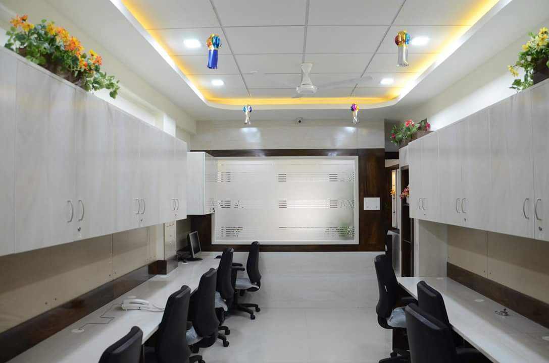 Open Office Space with White Cabinets and False Ceiling with Yellow neon lighting by Madhu Gunisetti Modern | Interior Design Photos & Ideas