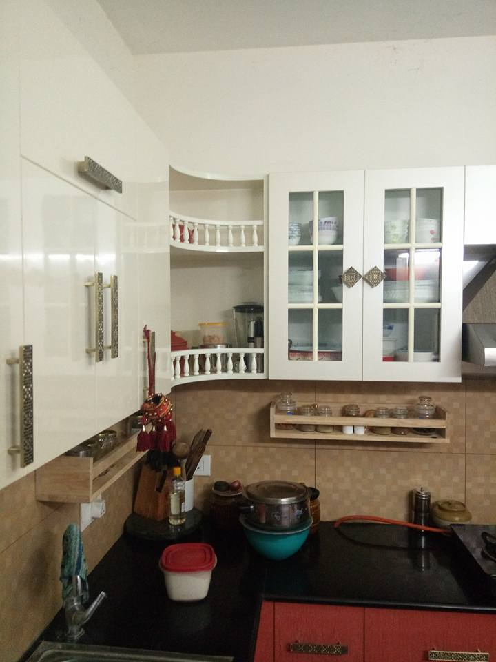 L shaped kitchen with white cabinets by Ganesh