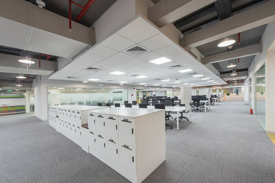 open office with white desk and black chairs by Ganesh Modern | Interior Design Photos & Ideas
