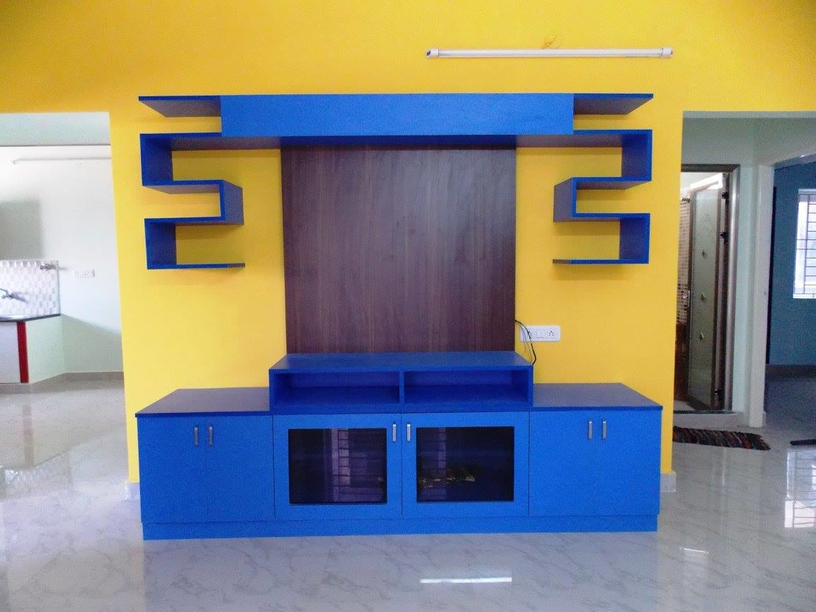 Modern display unit with yellow wall by Ganesh Indoor-spaces Modern | Interior Design Photos & Ideas