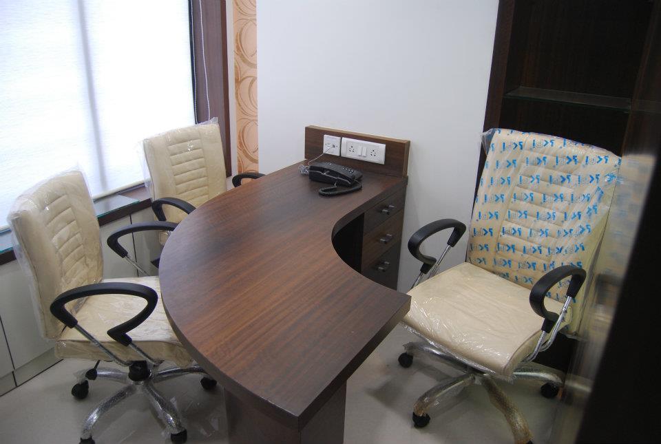 Curved Wooden Office Setup by Nilesh V. Gosavi Minimalistic | Interior Design Photos & Ideas