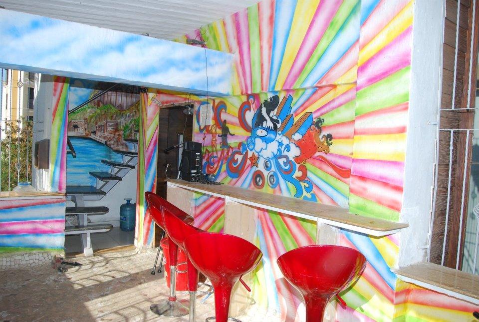 Pop Colored  cafe sitting area by Nilesh V. Gosavi Modern | Interior Design Photos & Ideas