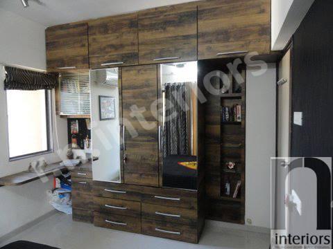 Minimalist Wooden Finished Wardrobe by Nilesh V. Gosavi Bedroom Minimalistic | Interior Design Photos & Ideas