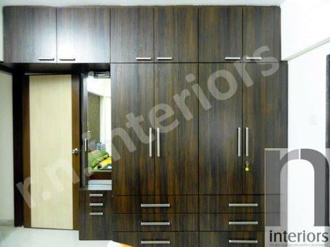 Minimalist Wooden Finish Closet by Nilesh V. Gosavi Bedroom Minimalistic | Interior Design Photos & Ideas