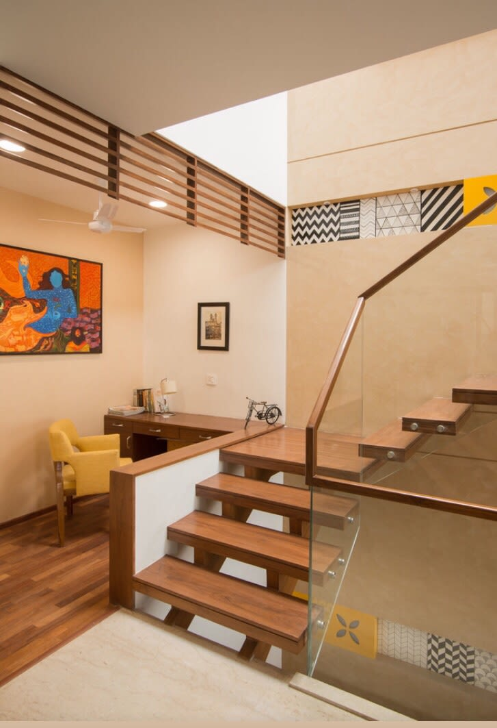 Walnut Brown Shaded Staircase With Glass Enclosure by Ganpat mistry Indoor-spaces Modern | Interior Design Photos & Ideas