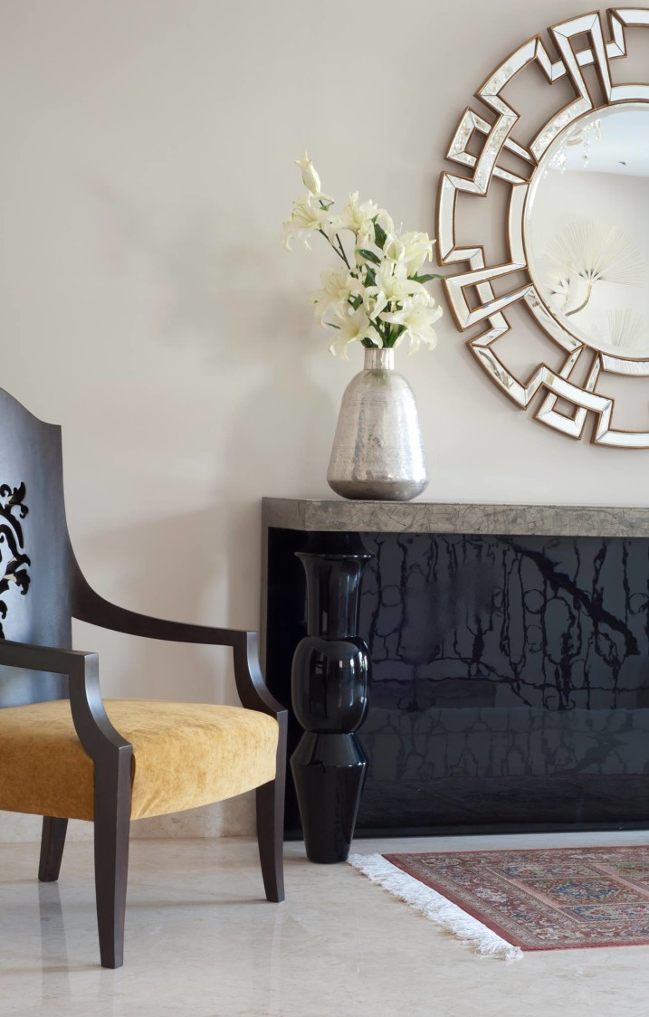 Wooden Cushioned Chair with Glossy Black Display Unit by Mayank Manchanda Living-room Minimalistic | Interior Design Photos & Ideas