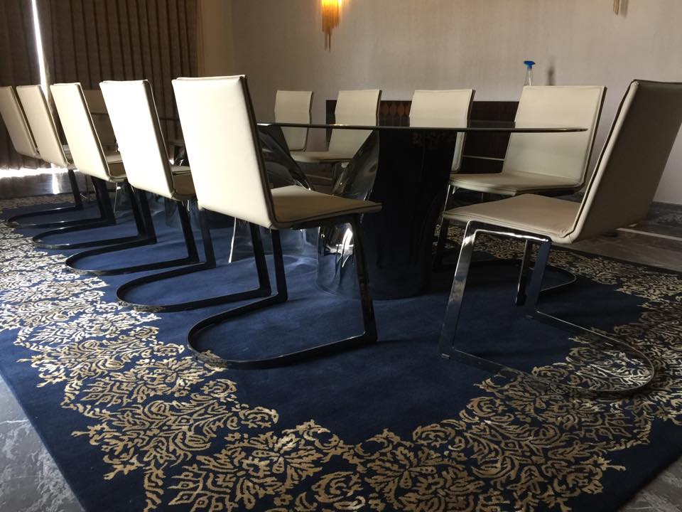 Conference Room with Black Table and Beige Chairs with Royal Blue Carpet by Mayank Manchanda Modern | Interior Design Photos & Ideas