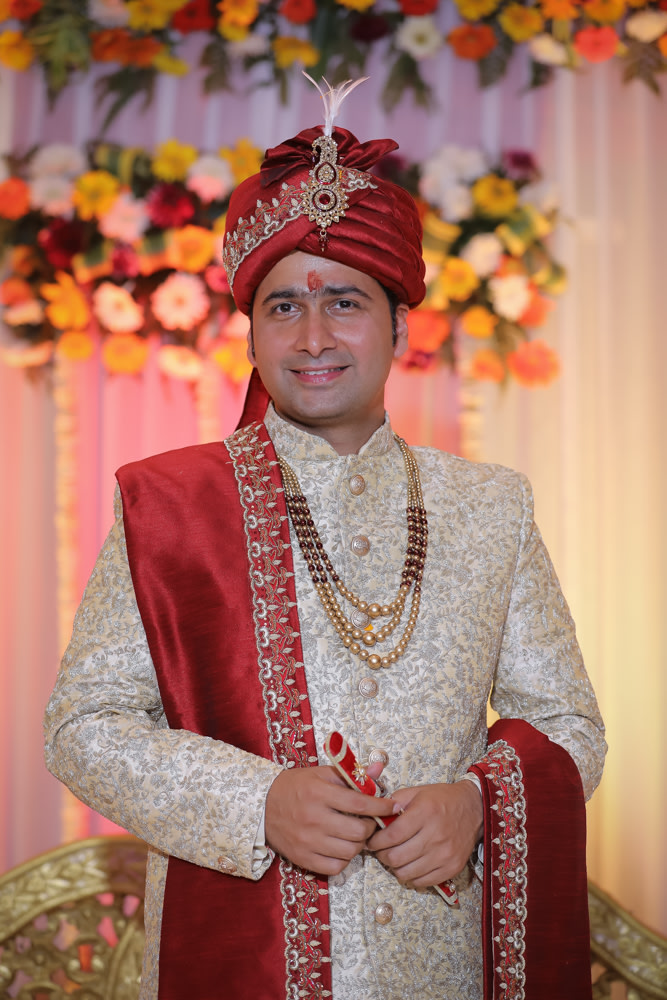 Groom Wearing Red Silk Turban With Gold Kilangi Brooch by Virendra Kumar Wedding-photography Groom-wear-and-accessories | Weddings Photos & Ideas