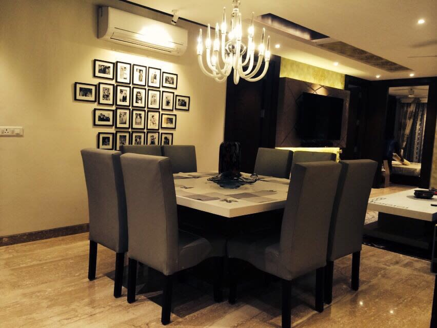 Beige Dining Room With Black Dining Chairs by Saurabh Garg Dining-room Contemporary | Interior Design Photos & Ideas