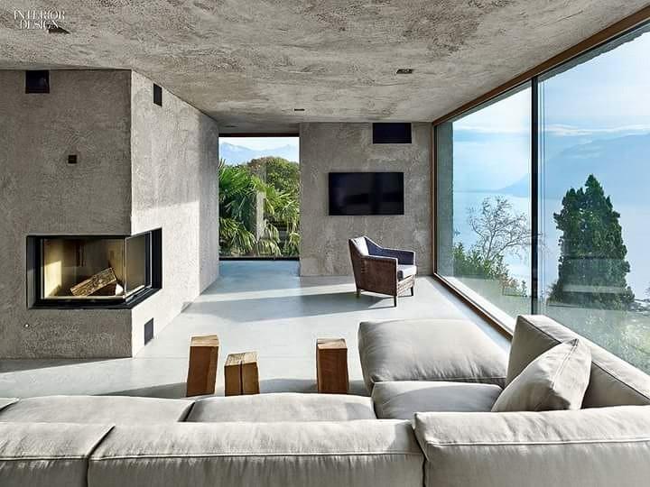 Spacious Living Room With Grey Sectional Sofa by Gestalt Interior Living-room Minimalistic | Interior Design Photos & Ideas