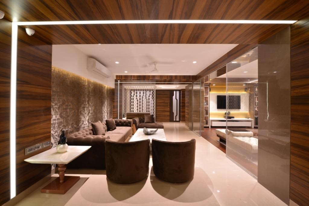 Spacious Living Room With Brown Sofas And Curve Lounge Chairs by Jeetan Ranpura Living-room Contemporary | Interior Design Photos & Ideas