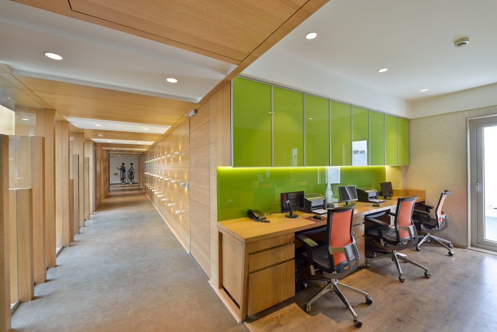 Green Cabinets And Wooden Desk In Office by Jeetan Ranpura Contemporary | Interior Design Photos & Ideas