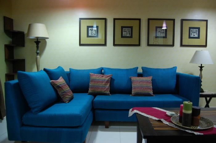 Living Room With Blue Sectional Sofas And Lamp by Nishajyoti Sharma Living-room | Interior Design Photos & Ideas