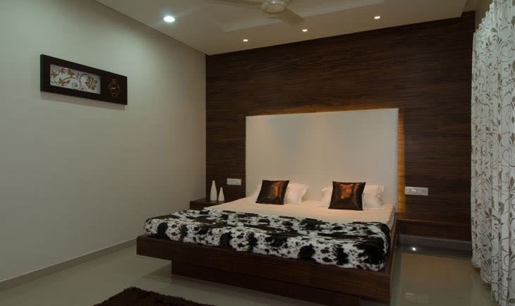 Low Rise Wooden Bed And White Head Cover by Deepti Srivastava Bedroom Contemporary | Interior Design Photos & Ideas