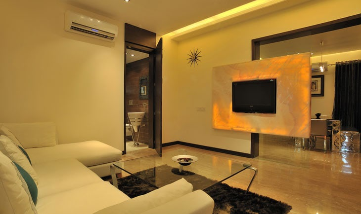 White Sectional Sofa And Glass Top Table by Deepti Srivastava Living-room Contemporary | Interior Design Photos & Ideas