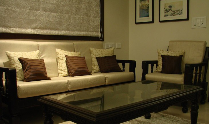 Wooden Cushioned Sofa And Glass Top Table by Deepti Srivastava Living-room Modern | Interior Design Photos & Ideas